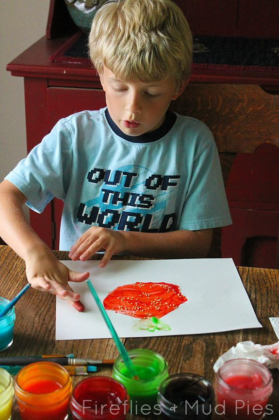 Painting a strawberry with strawberry scented fingerpaint! - Fireflies and Mud Pies