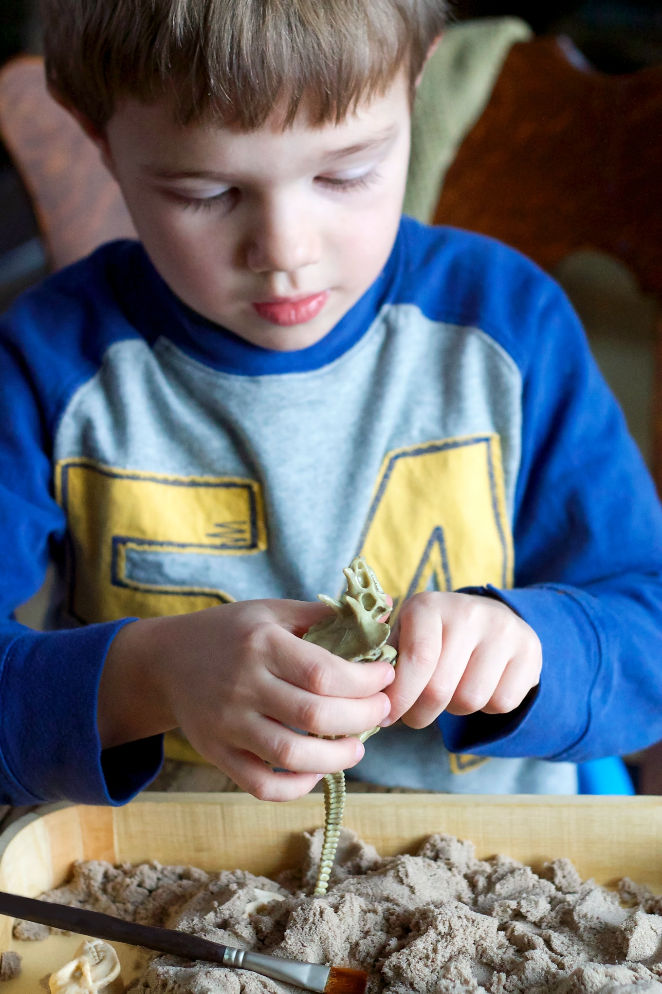 Preschooler Digging for Dinosaur Bones