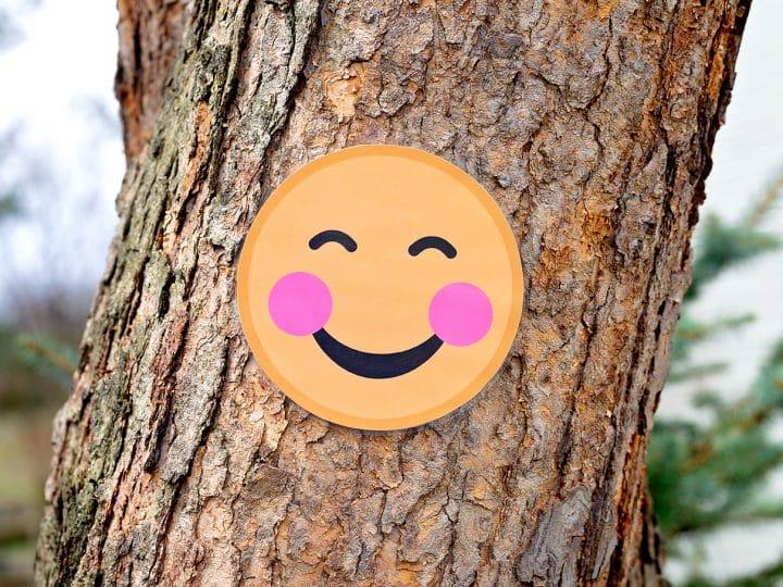 Blushing Smile Emoji on Tree