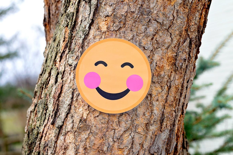 Blushing Emoji on Tree