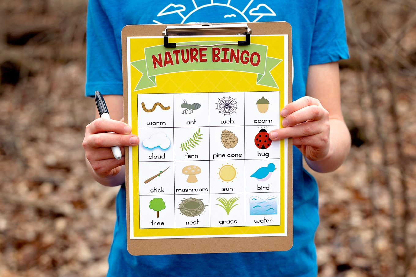 Boy Holding Yellow Nature BINGO Card