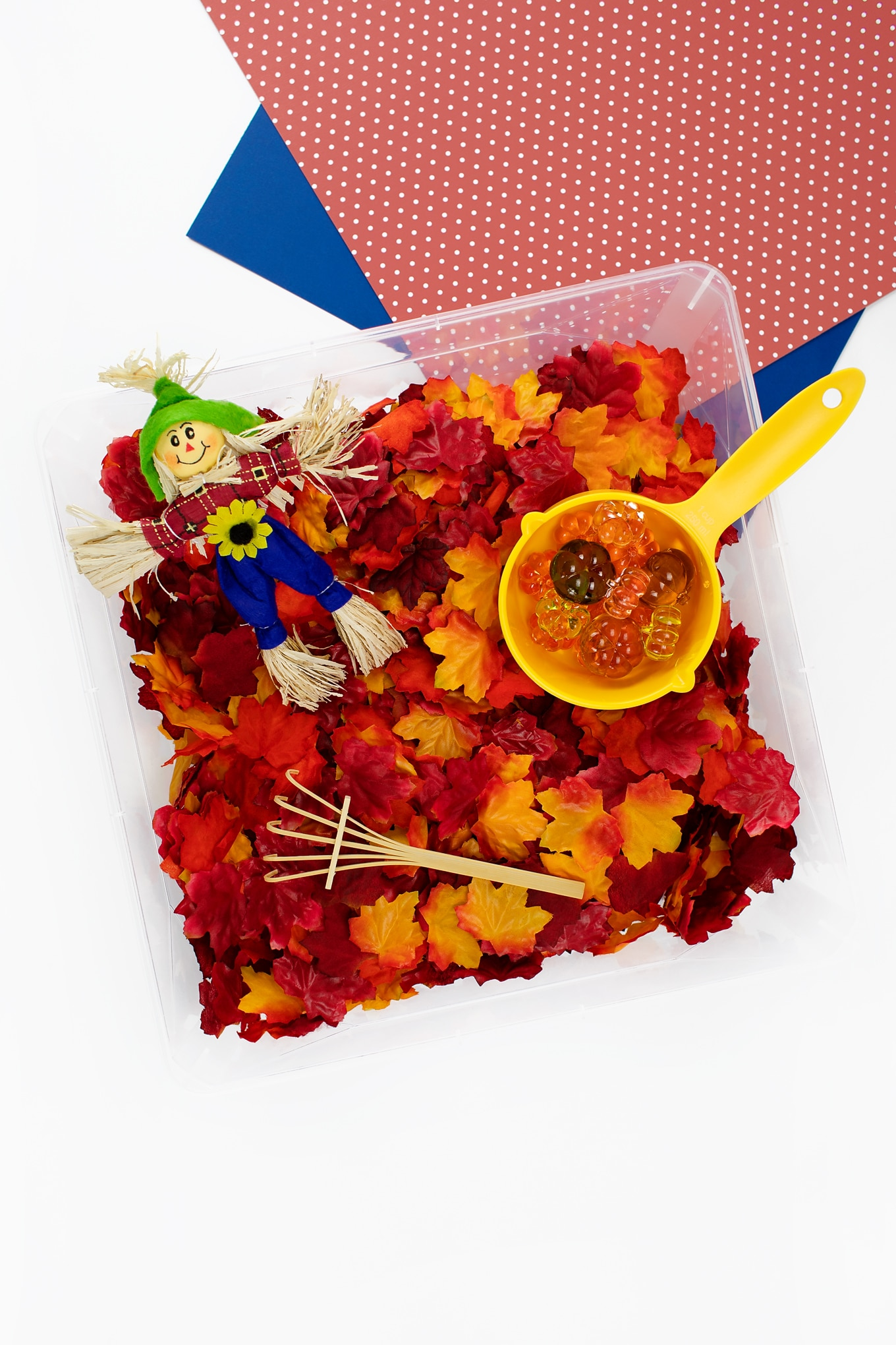 Fall Sensory Bin with Leaves and a Scarecrow