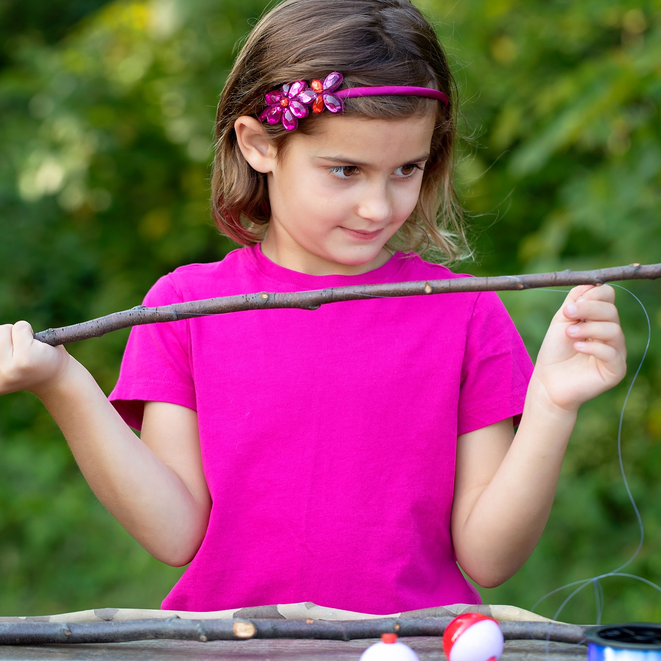 Child Making Classic Stick Fishing Pole