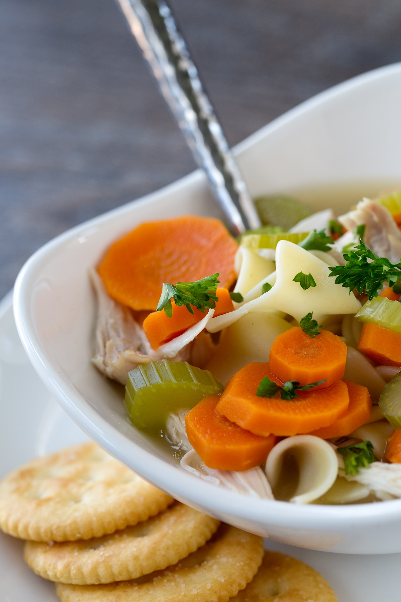 This simple and comforting Homemade Chicken Noodle Soup is loaded with healthy vegetables, soft noodles, and tender shredded chicken. My family loves the classic flavor and I love that it can be made quickly.