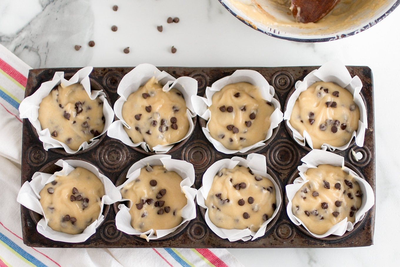 Chocolate Chip Muffin Batter in Muffin Tins