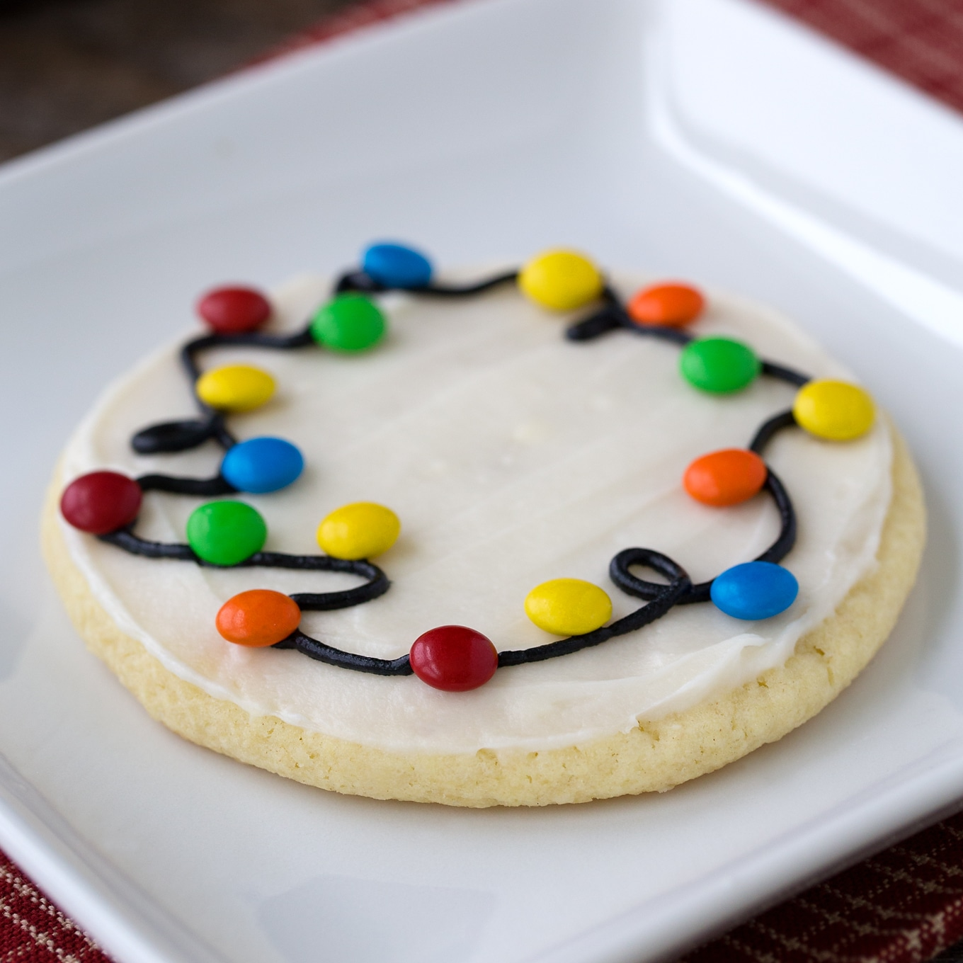 Guaranteed to please kids of all ages, Christmas Lights Cookies are an easy and fun Christmas cookie to make for holiday gatherings. Perfect for cookie exchanges!