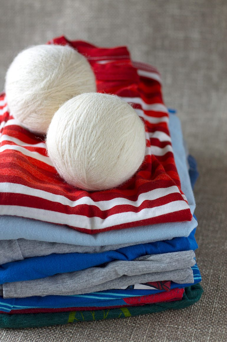 Discover money saving natural laundry tips and tricks and learn how to make wool dryer balls to soften clothes and speed drying time, naturally.