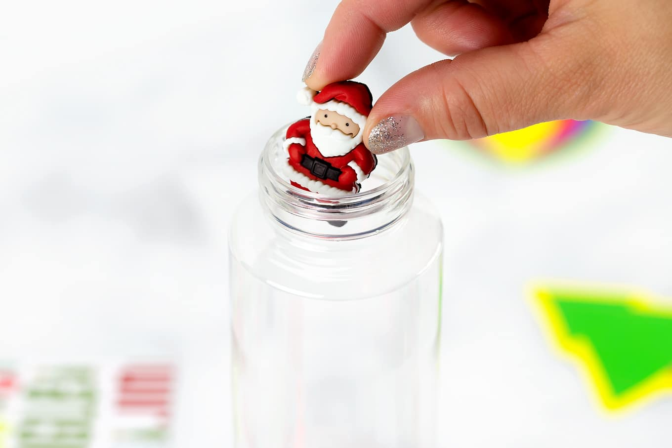 Santa Button Going Into Sensory Bottle