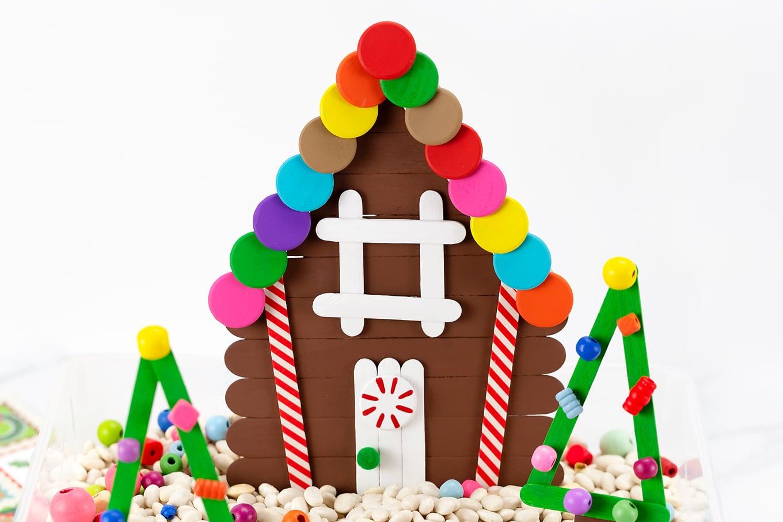 Popsicle Stick Gingerbread House Sensory Bin