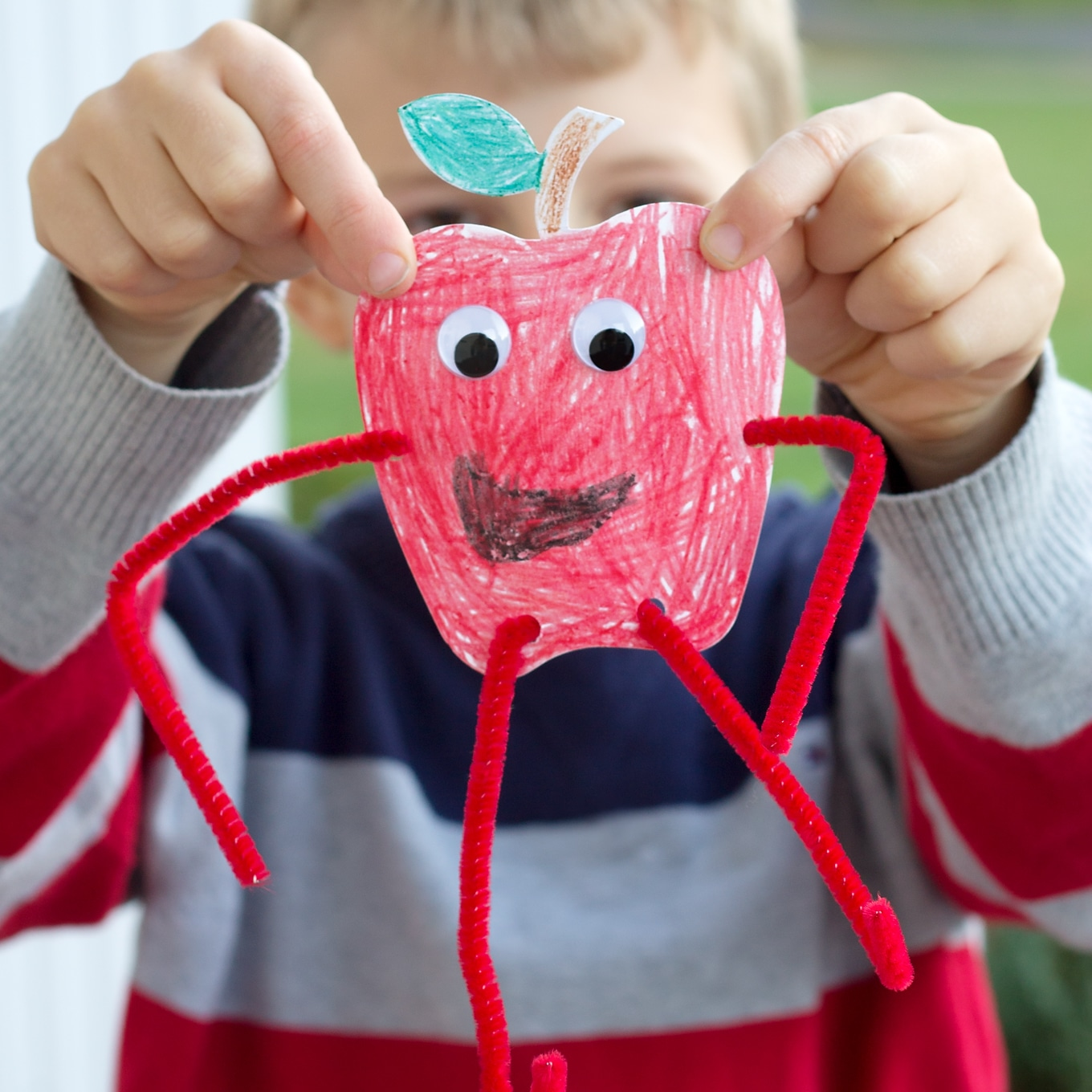 Child Holding Paper Apple Craft