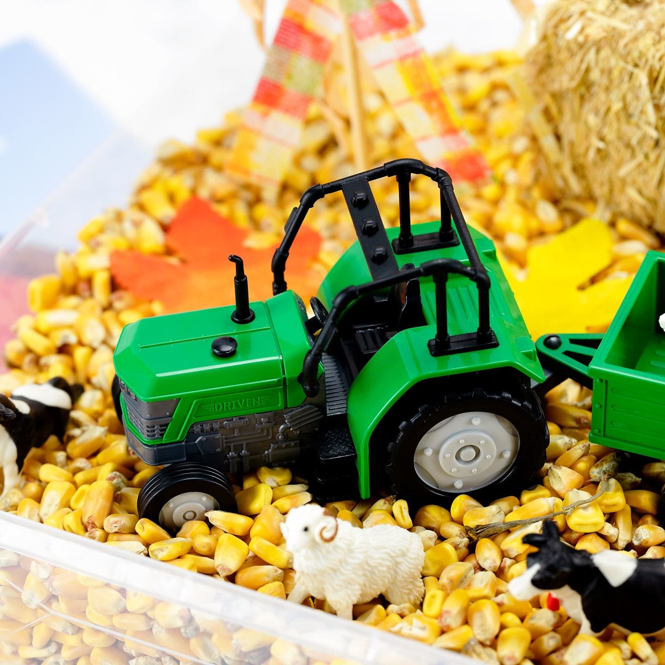 Toy Tractor in Corn Bin