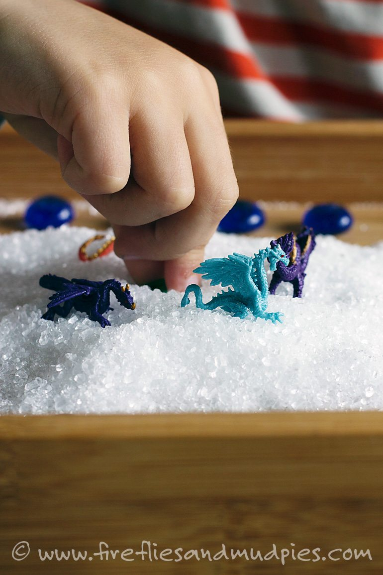 Playing with dragons in a salt sensory bin | Fireflies and Mud Pies