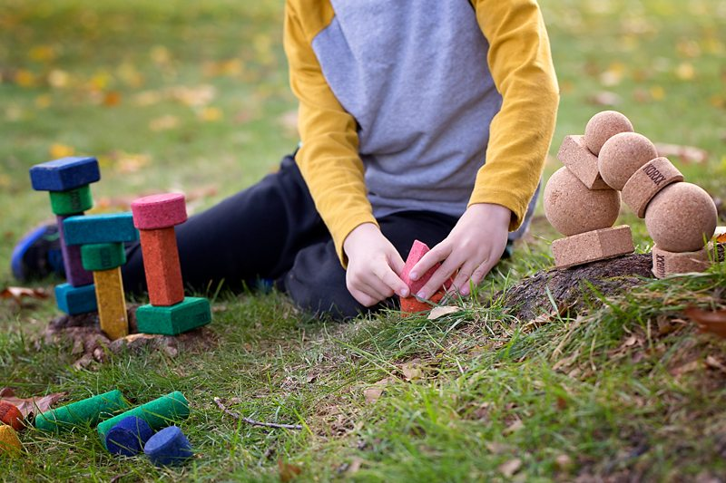 Need a creative toy? Kids of all ages enjoy pairing vibrant KORXX Blocks with acorns, pinecones, stones, feathers, twigs, and more for imaginative nature play.