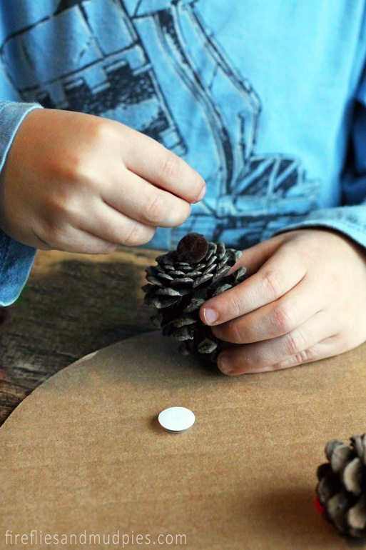 Kids will love creating Pine Cone Reindeer Ornaments this Christmas.