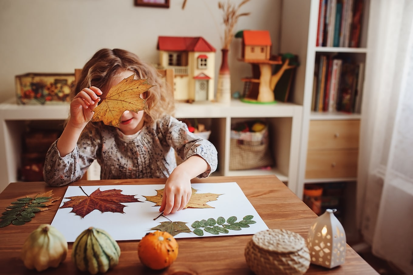 Child Enjoying a Fall Nature Craft