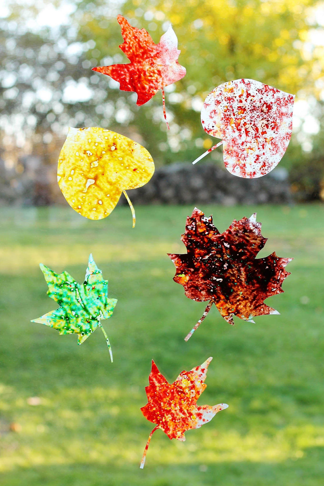 Brighten up your windows with Melted Crayon Leaf Suncatchers, a beautiful fall craft for kids!