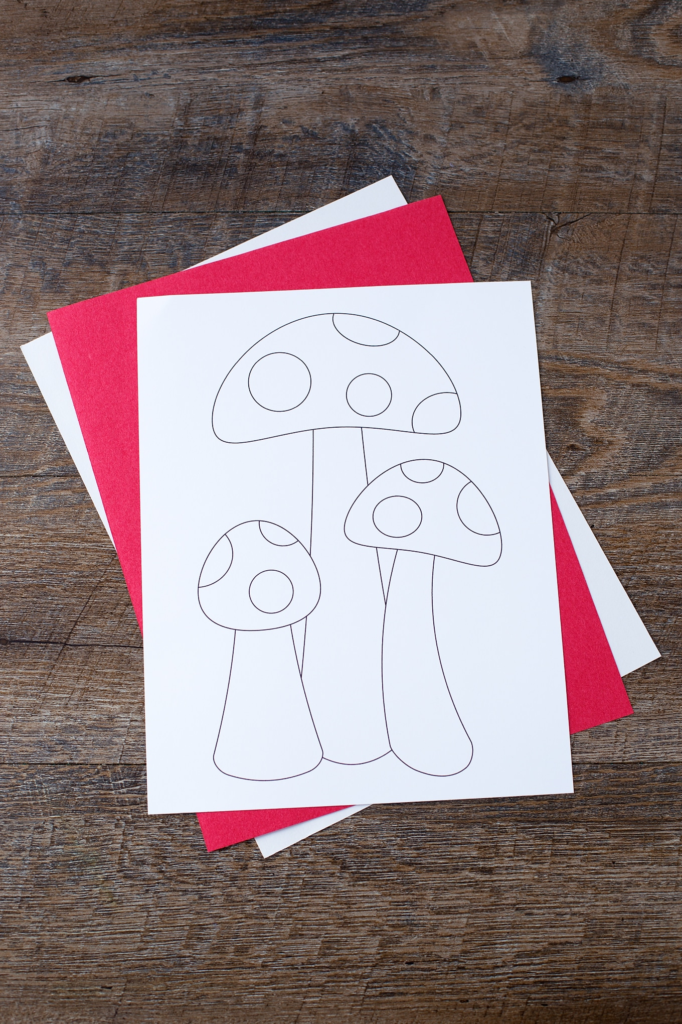 Kids will develop fine-motor skills and have fun while using our printable mushroom template to create colorful Torn Construction Paper Mosaic Mushroom Art.