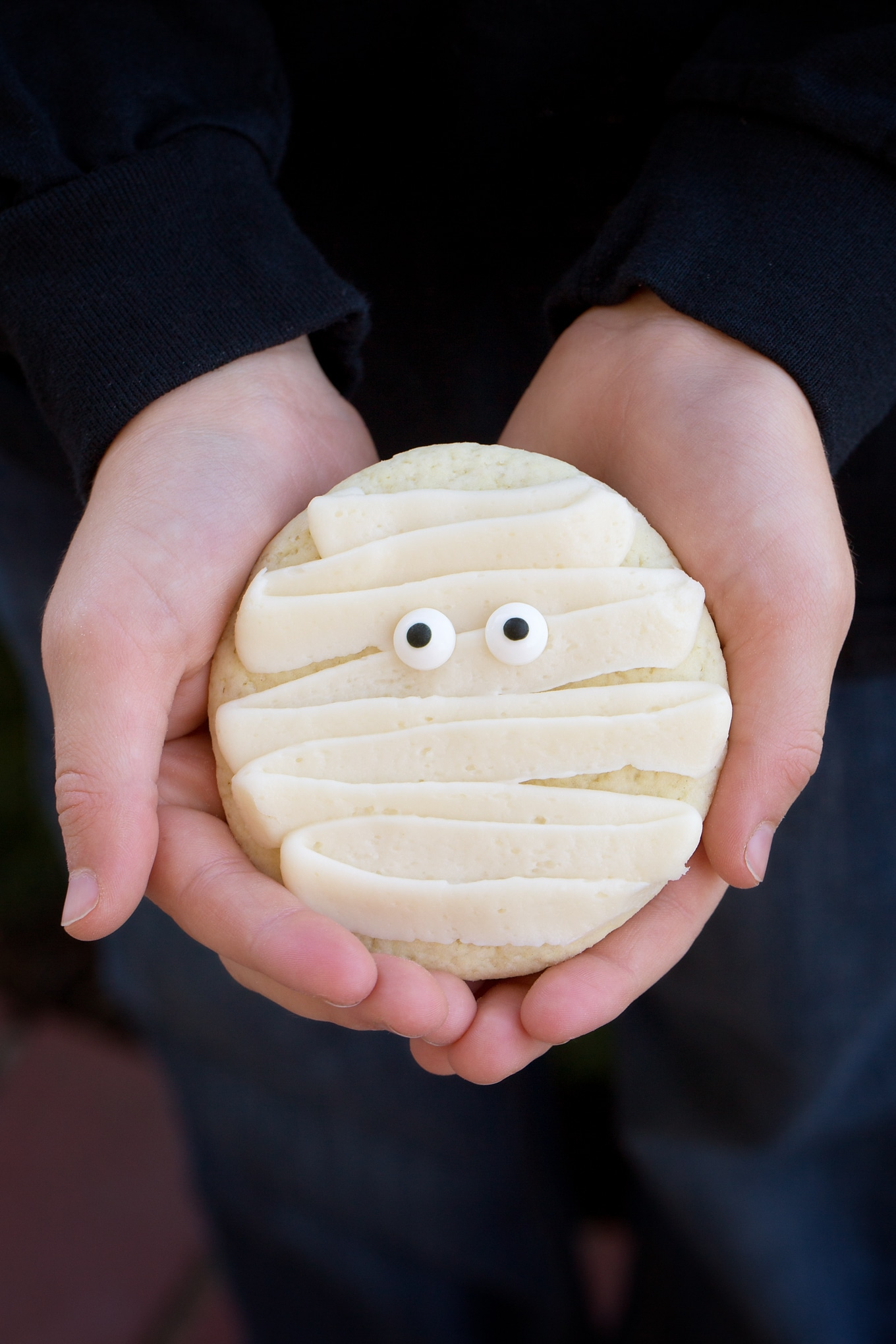 Child Holding Halloween Cookie