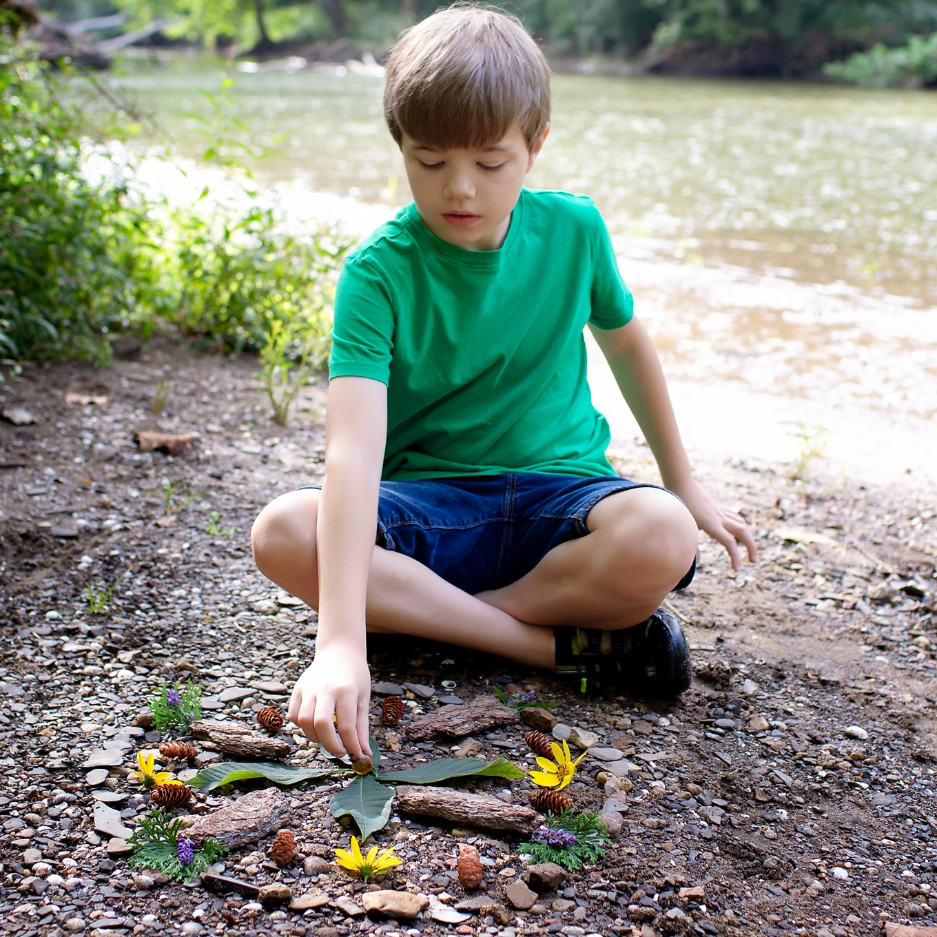 Child Creating a Nature Mandala - From the Book Sticks and Stones