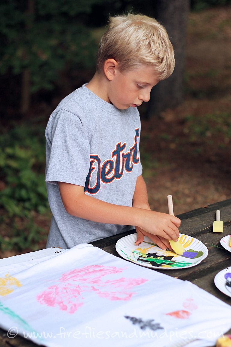 Stamp shirts with leaves and fabric paint.