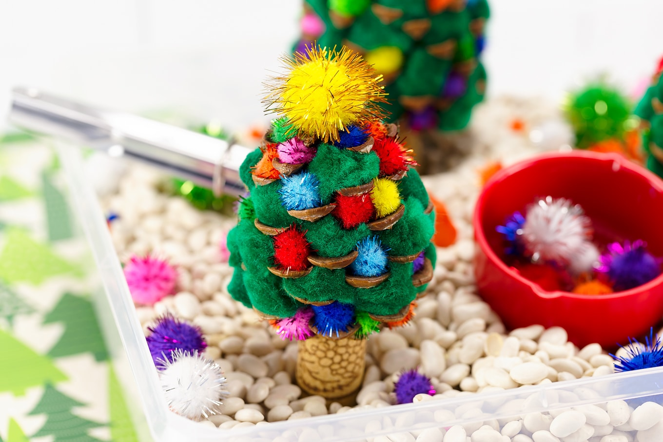 Pine Cone Christmas Trees in a Sensory Bin