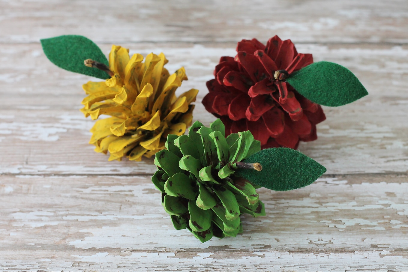 Kids of all ages will enjoy making pine cone apples. They are a creative, colorful fall nature craft for kids!