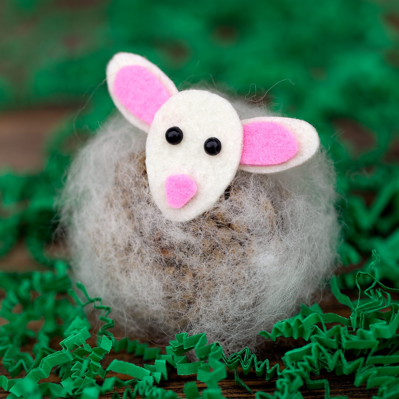 Pine Cone Lambs are a creative, easy, and fun spring nature craft for kids. Made with pine cones, wool, and kid-friendly craft supplies!