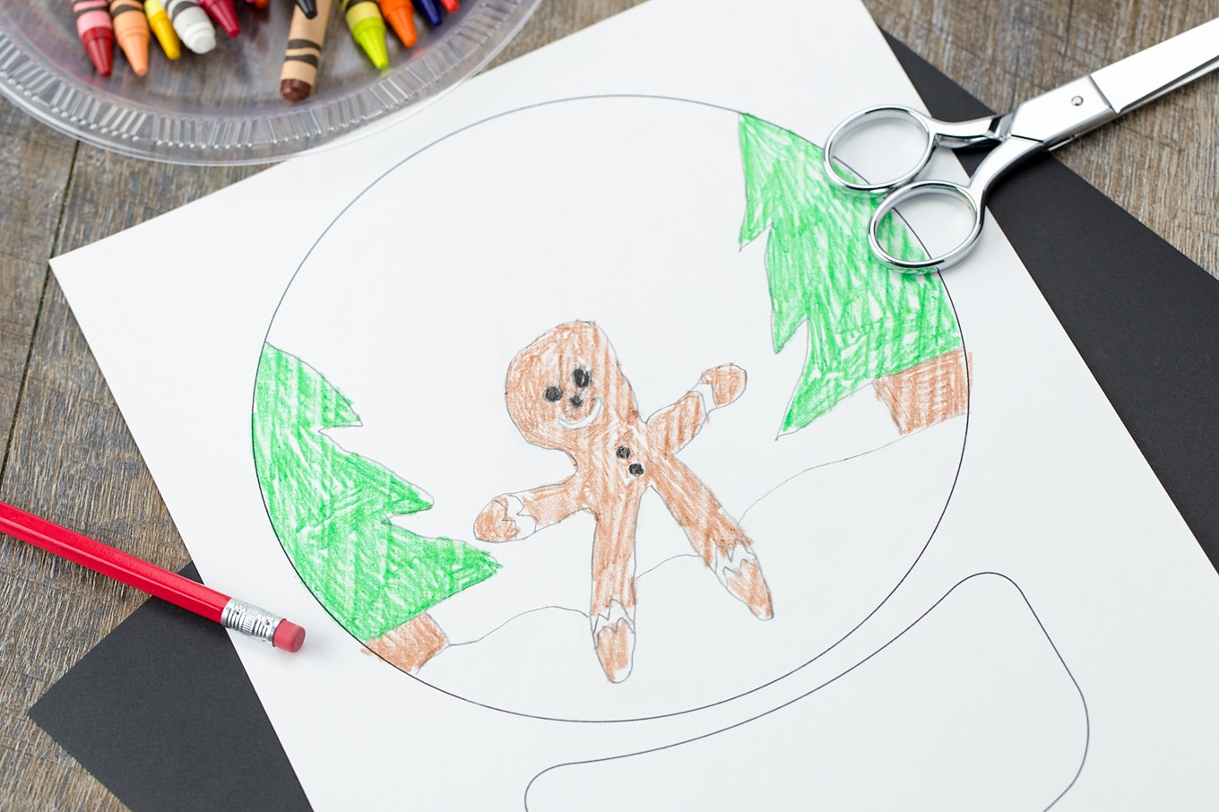 Kid-Made Gingerbread Drawing Inside of a Snow Globe