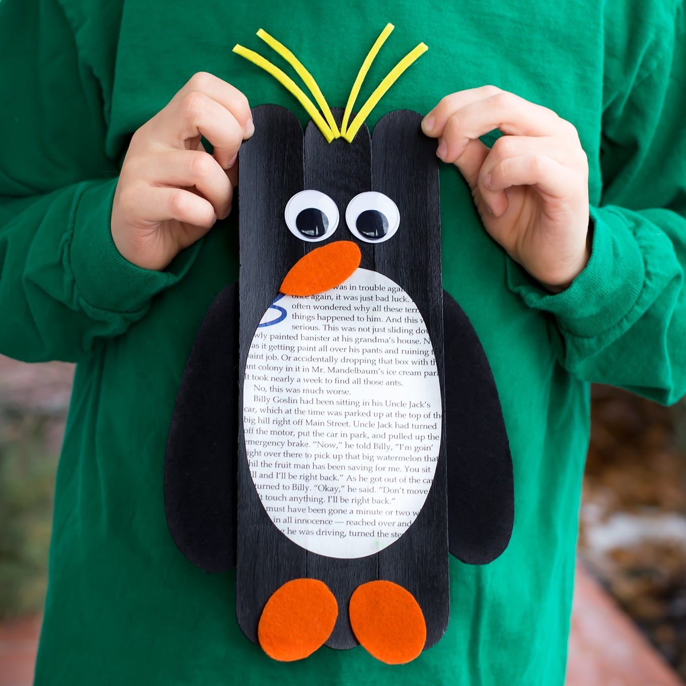 Child Holding Craft Stick Penguin