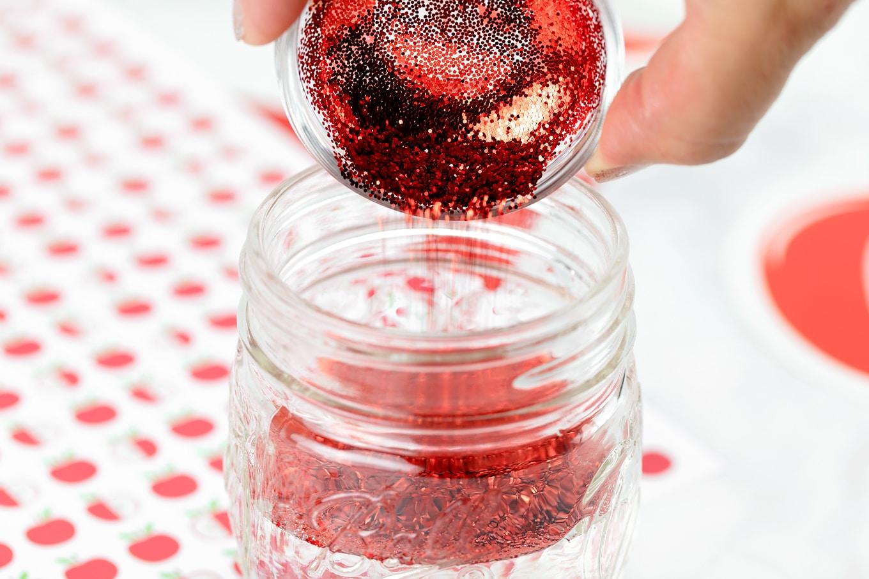 Sprinkling Glitter into Glitter Jar