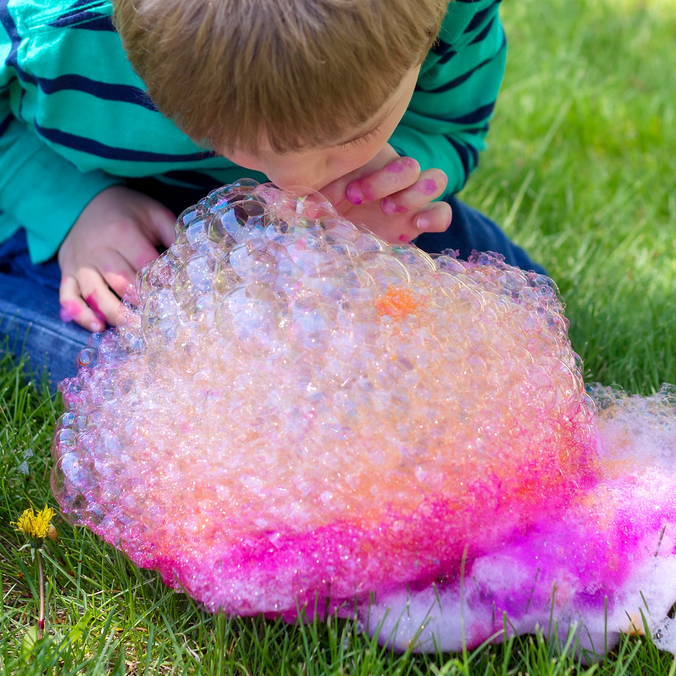 Child Blowing Bubbles for Bubble Painting