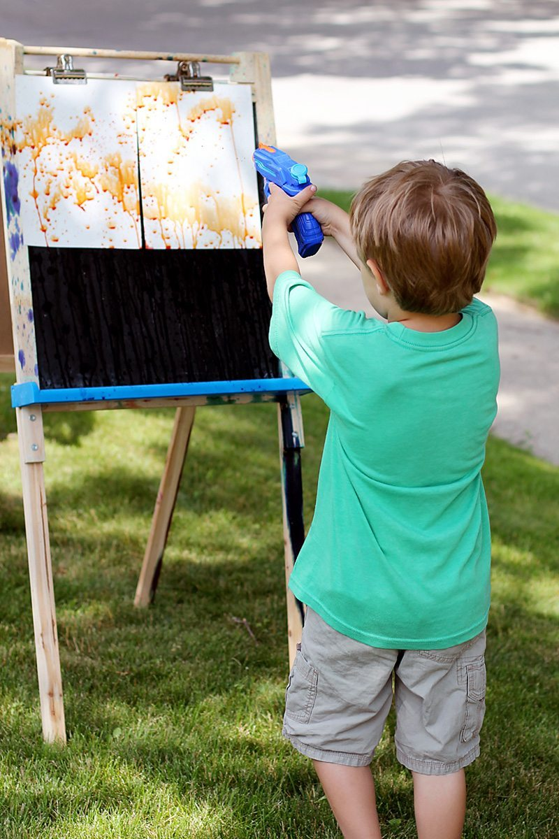Child Painting with Squirt Gun