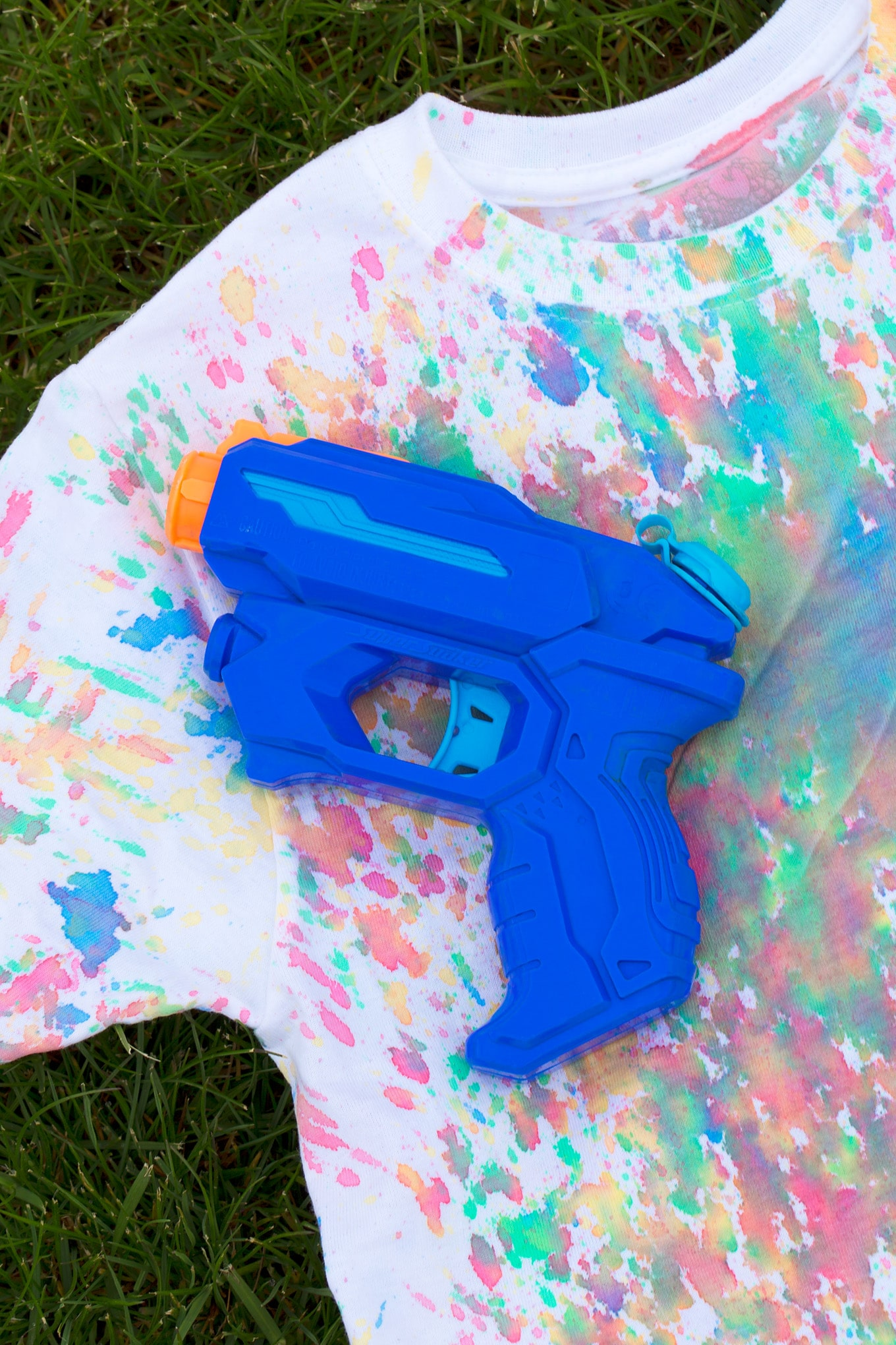 Squirt Gun Tie-Dye! Kids of all ages will enjoy using squirt guns to create vibrant, tie-dyed shirts! It's perfect for summer.