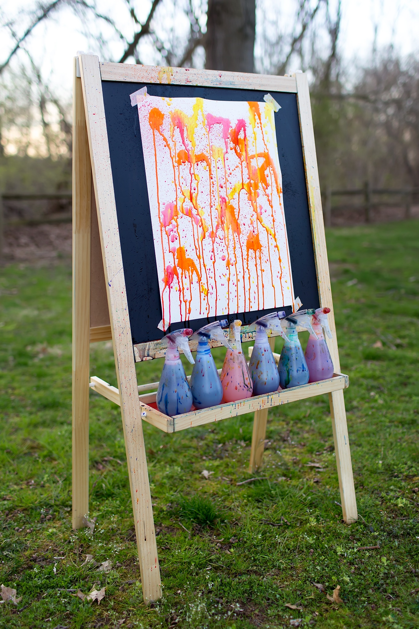 Easel With Orange, Red, and Yellow Squirt Painting