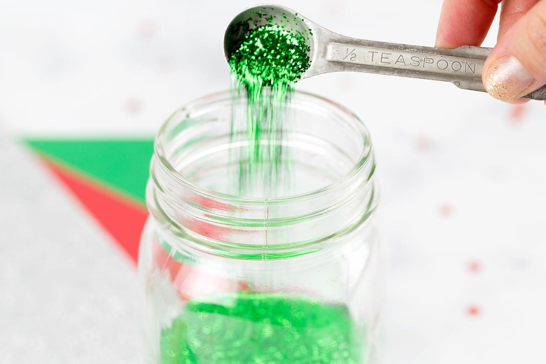 Step 3 of Glitter Jars - Pour Glitter into Jar