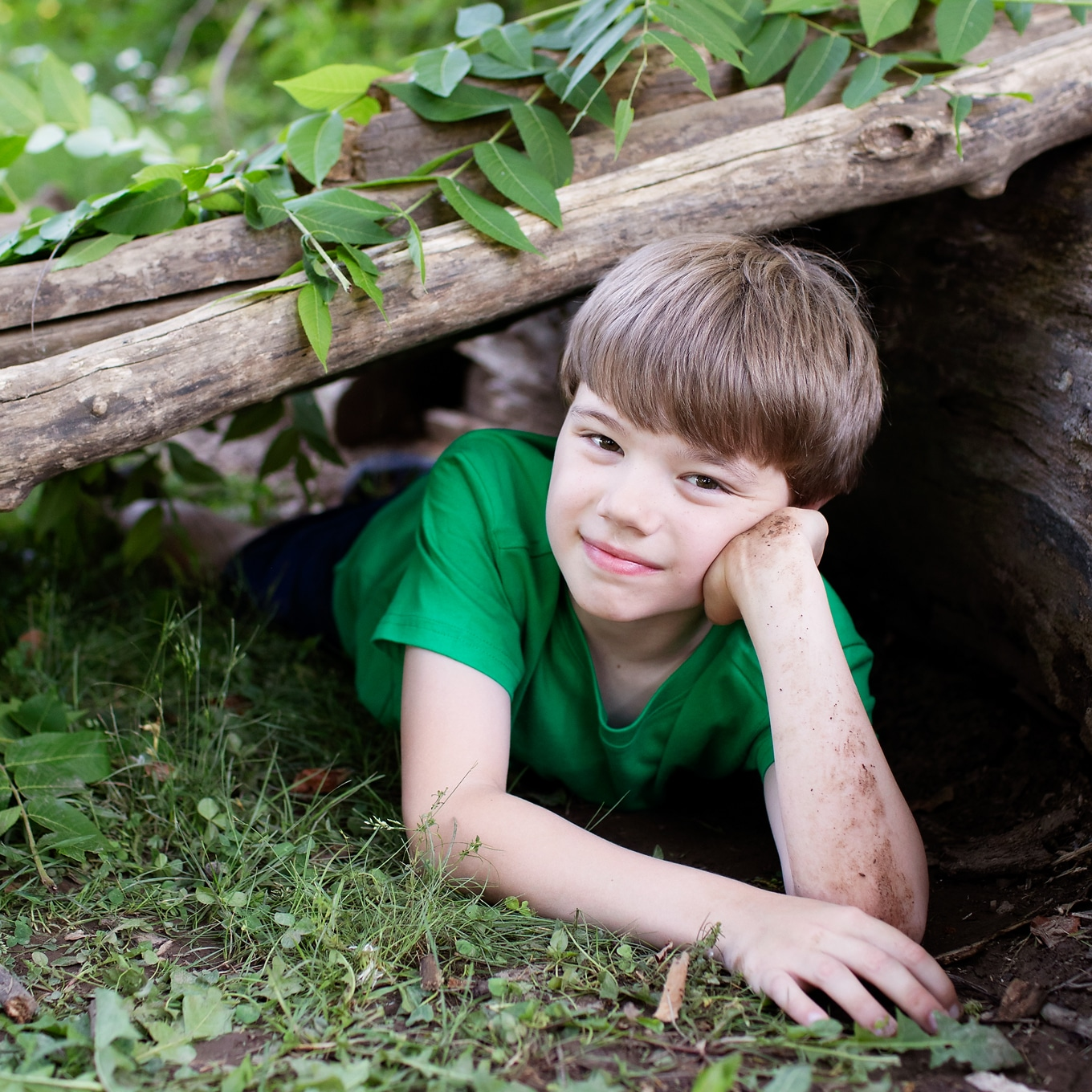Child Playing in Log Fort