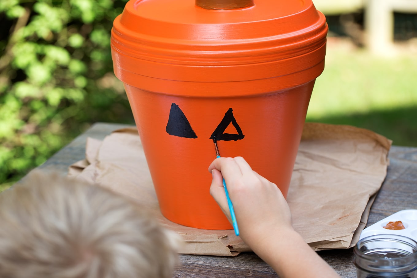 Bring a little Halloween fun to your garden, patio, or porch with this easy Terracotta Pot Jack O'Lantern Craft. It's a fun Halloween craft for kids!