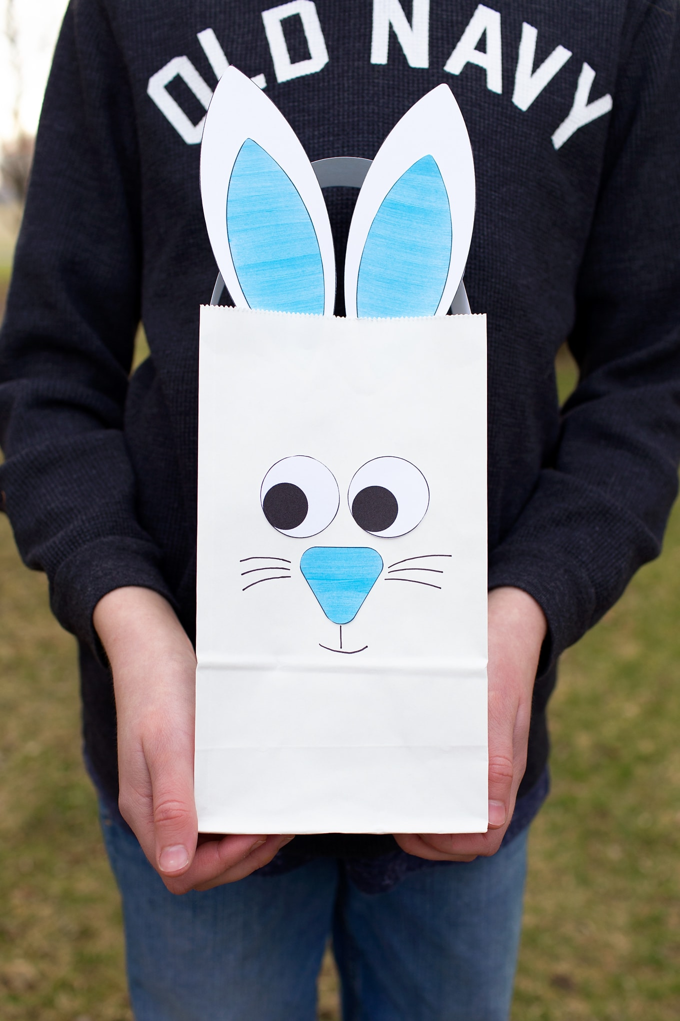 Boy Holding Paper Bag Bunny