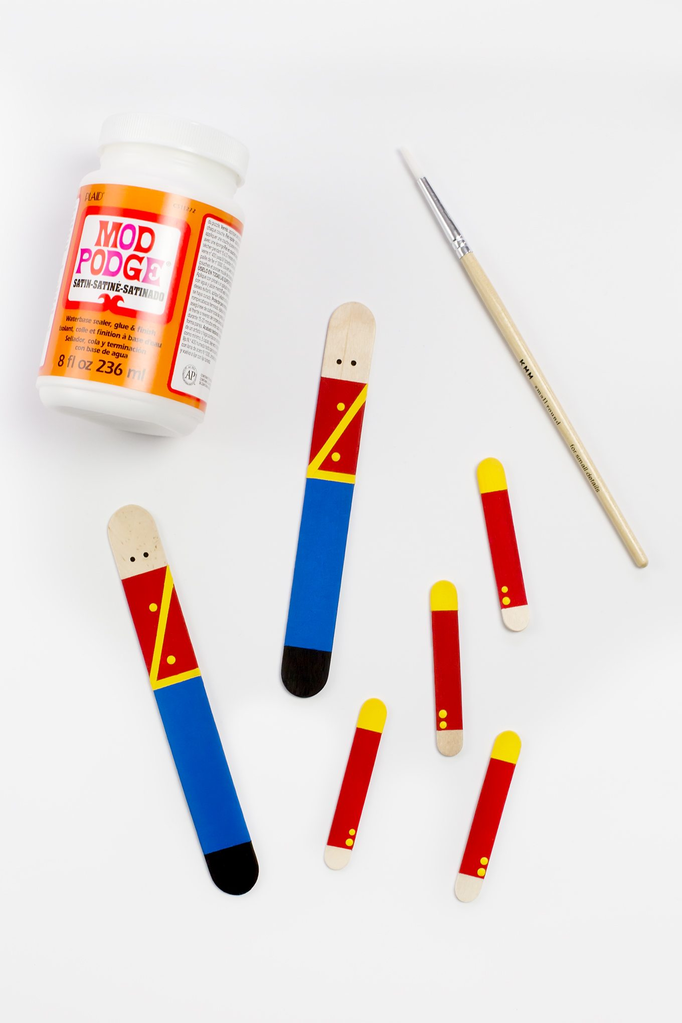 Crafters big and small will delight in making a Wooden Toy Soldier Ornament with craft sticks, paint, and one extra unique craft material.