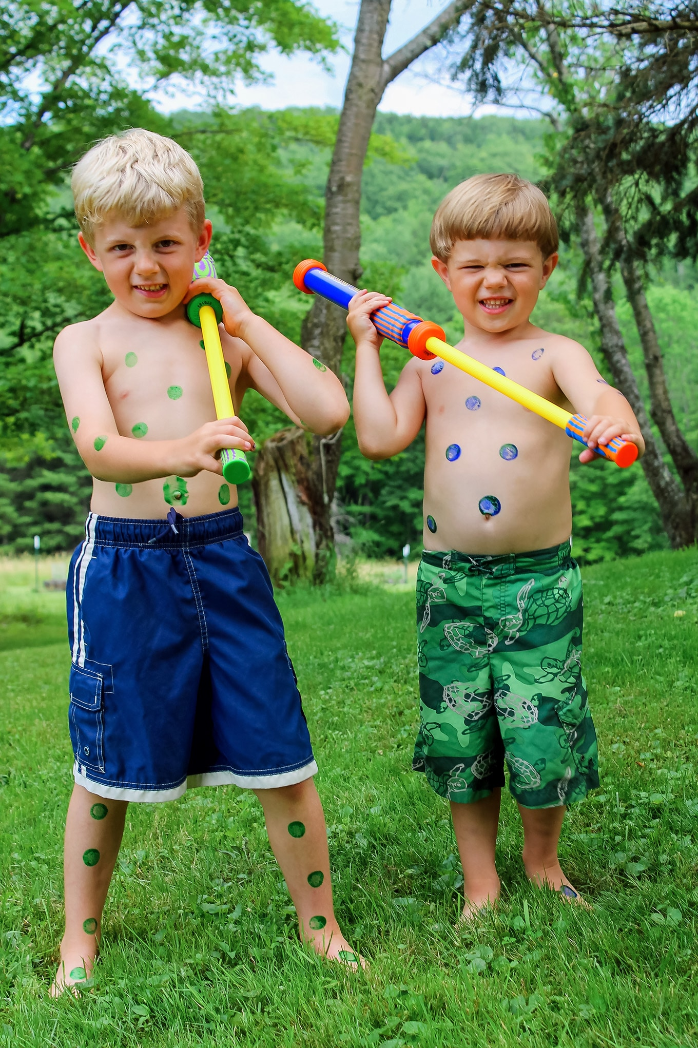 Two Children Ready for Water Blaster Games
