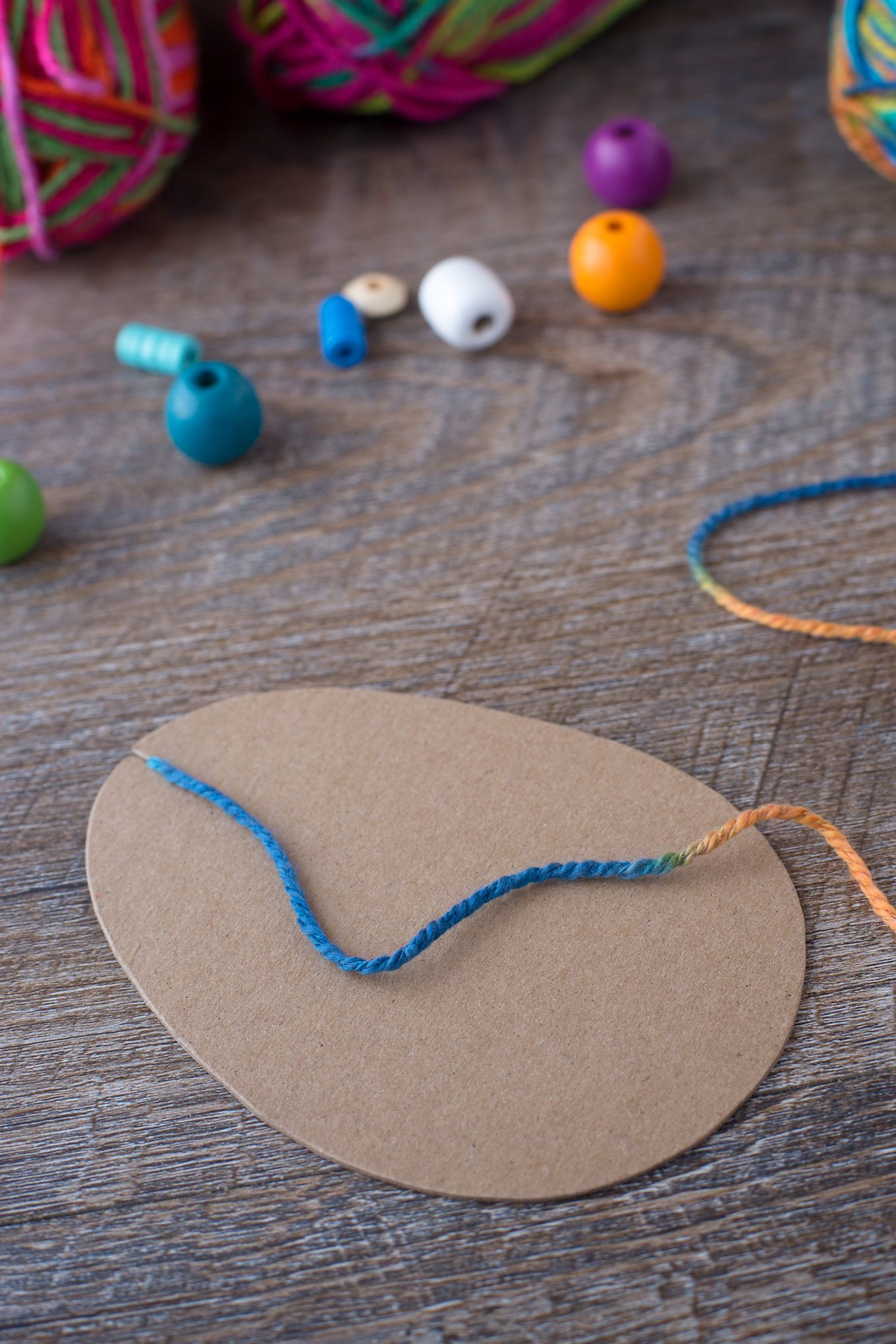 Just in time for Easter, kids can learn how to make a colorful Yarn Wrapped Easter Egg Craft at school or home. Such a pretty fine-motor craft for kids!