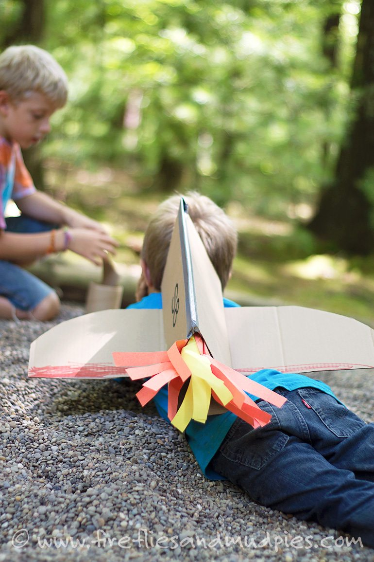 Imaginative play with cardboard jetpacks. | Fireflies and Mud Pies