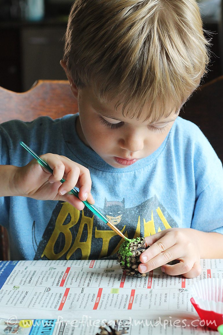 Painting pine cone apples for a fall nature craft. | Fireflies and Mud Pies
